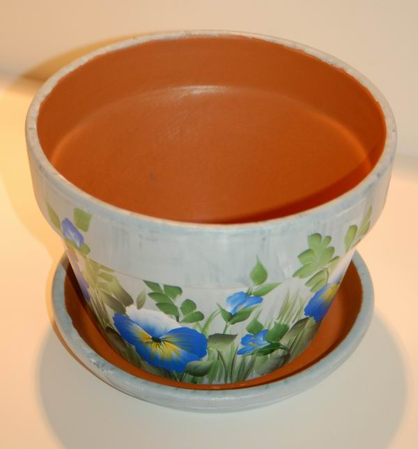 Painted Clay Pot Designs http://www.paintedblossoms.com/Flower_Pots.html