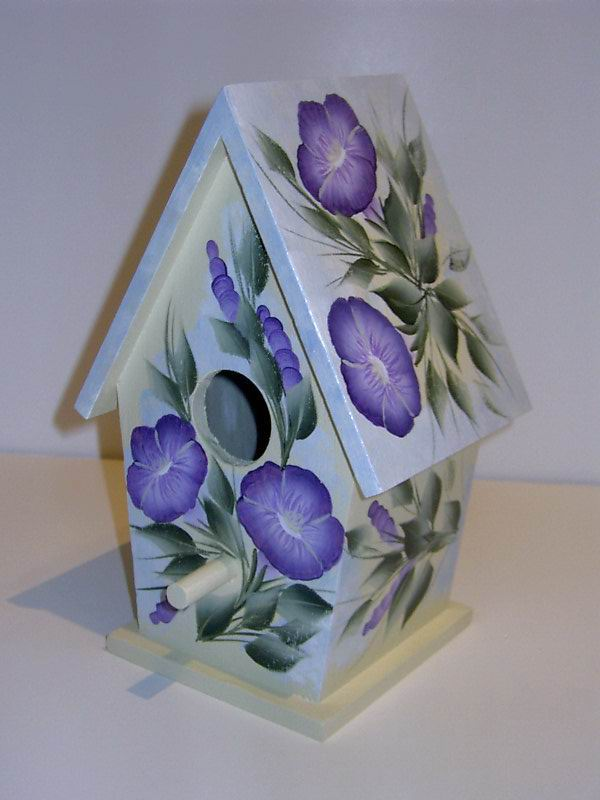 One of a kind hand painted birdhouses